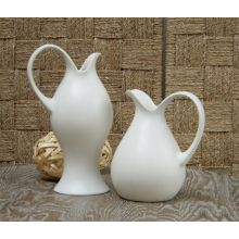 Set of 2 Ivory Pitchers